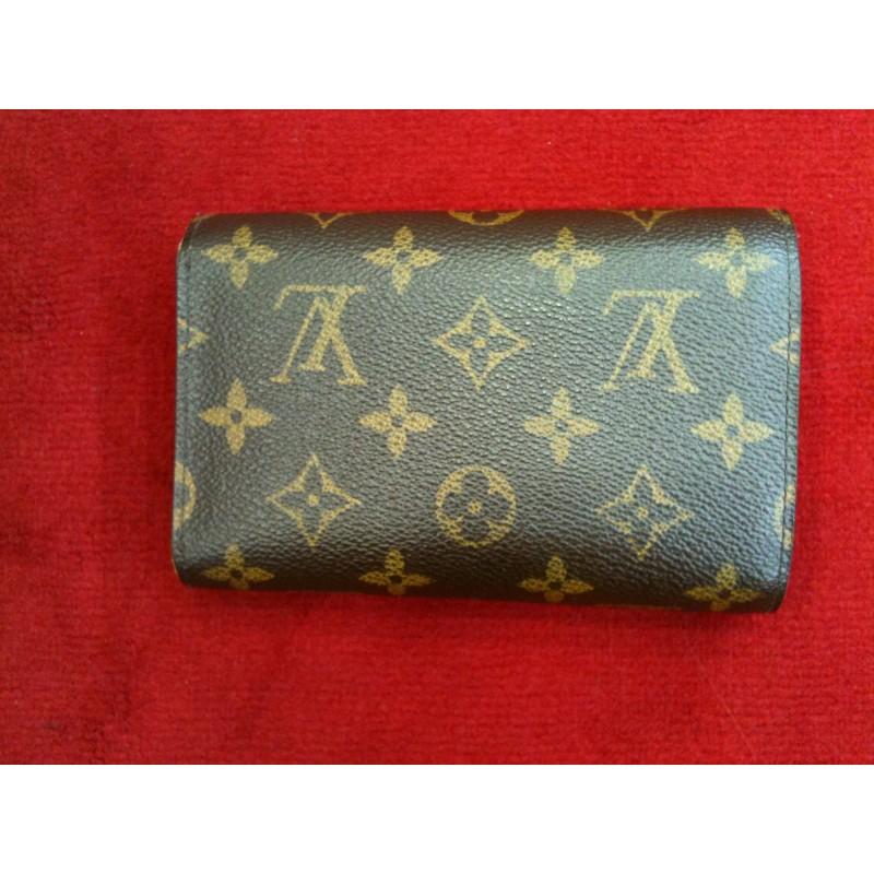 Portefeuille Louis Vuitton Alexandra en toile monogram. Vendu cb8df3e01d8