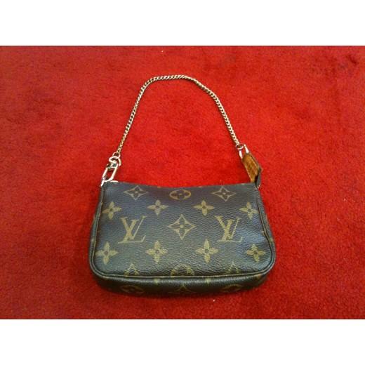 tout neuf cd237 170db Mini Pochette Accessoires Louis Vuitton en toile monogram
