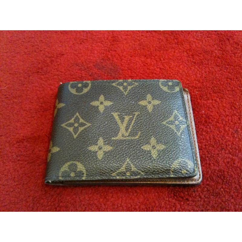 6ced054236c Portefeuille Louis Vuitton multiple en toile monogram. Vendu