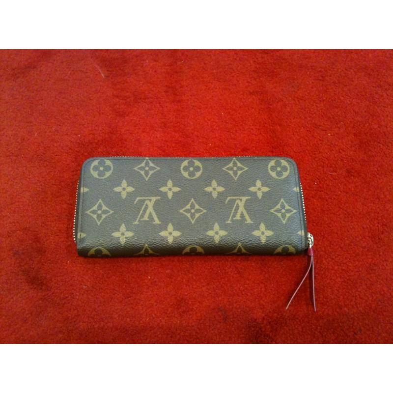 a4a9fffdff2c Portefeuille Louis Vuitton Clémence en toile monogram. Vendu