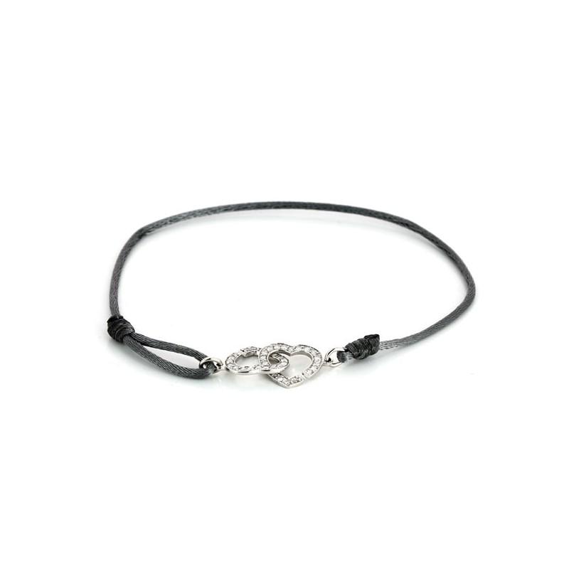 e4203644351 Bracelet Dinh Van Double coeur R12 en or blanc et diamants. Vendu