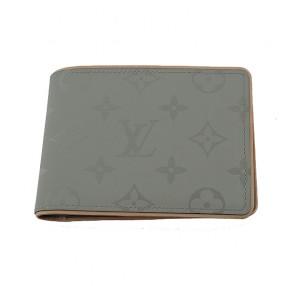 231d72d56ff Portefeuille Louis Vuitton multiple en toile.